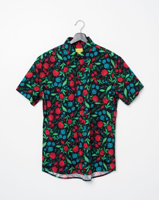 A product flat of a hawaiian casual button down short sleeve shirt covered with red, blue and green flowers