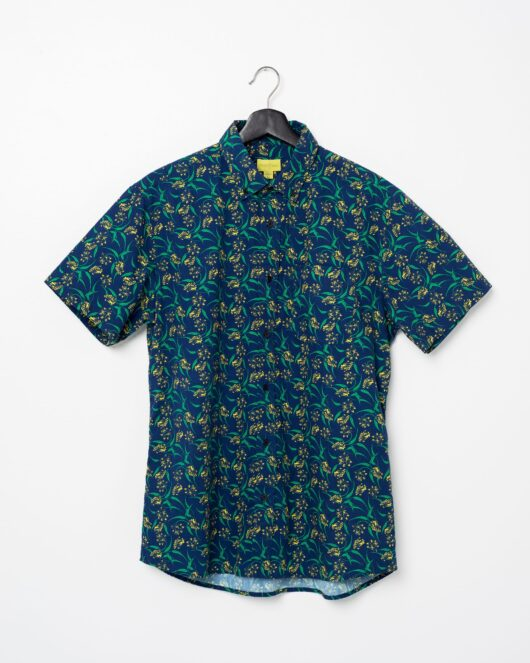A product flat of a floral blue yellow and green casual button down short sleeve shirt