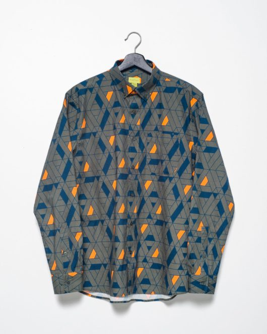 A product flat of a green casual button down long sleeve shirt with an all over blue and orange geometric print
