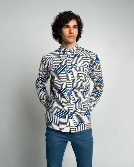 A white and blue casual button down long sleeve shirt with an all over stripe print worn by a handsome young man in blue jeans