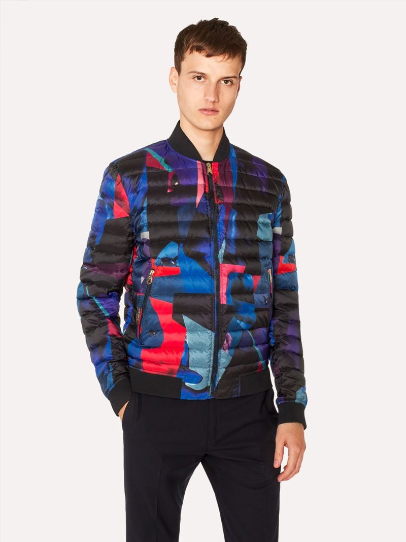 A young man wearing a Paul Smith Rose Bomber