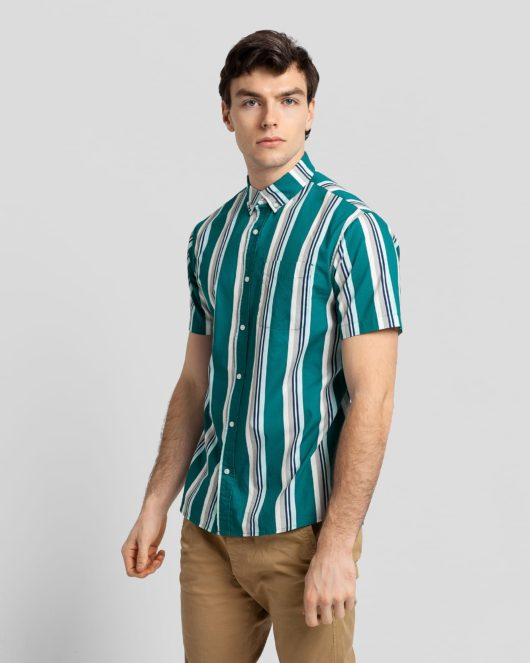 A casual button down short sleeve shirt with green, white, grey and blue stripes worn by a handsome young man in brown khakis